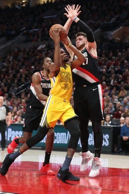Feb 13, 2019; Portland, OR, USA; Golden State Warriors forward Kevin Durant (35) drives on Portland Trail Blazers center Jusuf Nurkic (27) in the first half at Moda Center. Mandatory Credit: Jaime Valdez-USA TODAY Sports