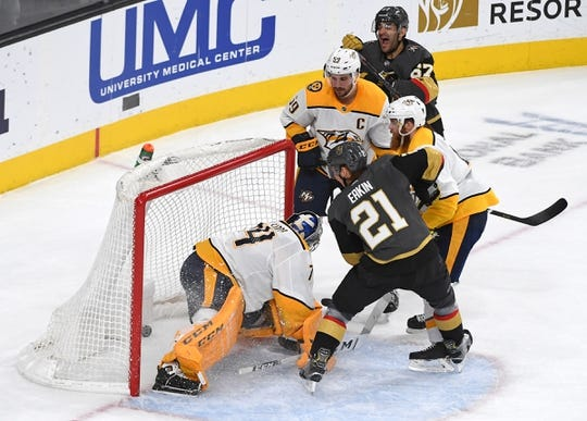 Feb 16, 2019; Las Vegas, NV, USA; Vegas Golden Knights left wing Max Pacioretty (67) reacts after tipping the puck through the legs of Nashville Predators goaltender Juuse Saros (74) for a first period goal at T-Mobile Arena. Mandatory Credit: Stephen R. Sylvanie-USA TODAY Sports