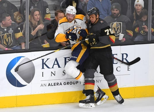 Feb 16, 2019; Las Vegas, NV, USA; Vegas Golden Knights right wing Ryan Reaves (75) checks Nashville Predators defenseman Mattias Ekholm (14) during the first period at T-Mobile Arena. Mandatory Credit: Stephen R. Sylvanie-USA TODAY Sports