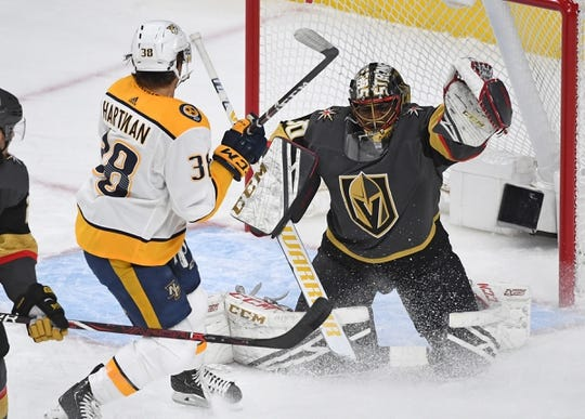 Feb 16, 2019; Las Vegas, NV, USA; Vegas Golden Knights goaltender Malcolm Subban (30) gloves the puck as Nashville Predators right wing Ryan Hartman (38) looks for a rebound during the first period at T-Mobile Arena. Mandatory Credit: Stephen R. Sylvanie-USA TODAY Sports