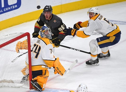 Feb 16, 2019; Las Vegas, NV, USA; Vegas Golden Knights defenseman Nate Schmidt (88) reacts after Nashville Predators goaltender Juuse Saros (74) deflects his shot over the net during the first period at T-Mobile Arena. Mandatory Credit: Stephen R. Sylvanie-USA TODAY Sports