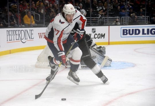 February 18, 2019; Los Angeles, CA, USA; Washington Capitals right wing T.J. Oshie (77) moves the puck against the Los Angeles Kings during the first period at Staples Center. Mandatory Credit: Gary A. Vasquez-USA TODAY Sports