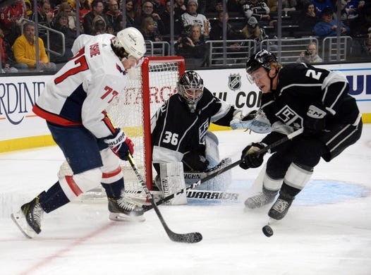 February 18, 2019; Los Angeles, CA, USA; Los Angeles Kings defenseman Paul LaDue (2) helps goaltender Jack Campbell (36) defend the goal against Washington Capitals right wing T.J. Oshie (77) during the first period at Staples Center. Mandatory Credit: Gary A. Vasquez-USA TODAY Sports