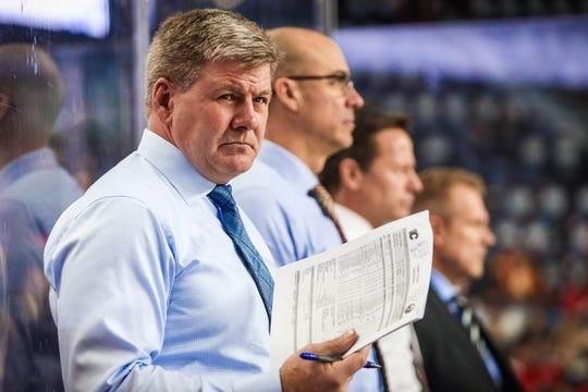 Feb 20, 2019; Calgary, Alberta, CAN; Calgary Flames head coach Bill Peters on his bench during the warmup period against the New York Islanders at Scotiabank Saddledome. Mandatory Credit: Sergei Belski-USA TODAY Sports