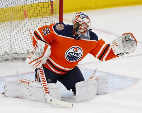 Feb 21, 2019; Edmonton, Alberta, CAN; Edmonton Oilers goaltender Mikko Koskinen (19) makes a save during warmup before a game against the New York Islanders at Rogers Place. Mandatory Credit: Perry Nelson-USA TODAY Sports
