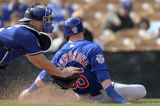 Feb 25, 2019; Phoenix, AZ, USA; Chicago Cubs second baseman Trent Giambrone (85) is tagged out at home plate by Los Angeles Dodgers catcher Austin Barnes during the first inning at Camelback Ranch. Mandatory Credit: Joe Camporeale-USA TODAY Sports