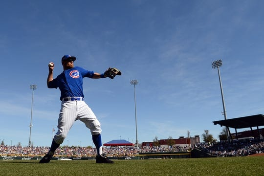 Mar 3, 2019; Mesa, AZ, USA; Chicago Cubs left fielder Ben Zobrist (18) warms up prior to facing the Chicago White Sox at Sloan Park. Mandatory Credit: Joe Camporeale-USA TODAY Sports