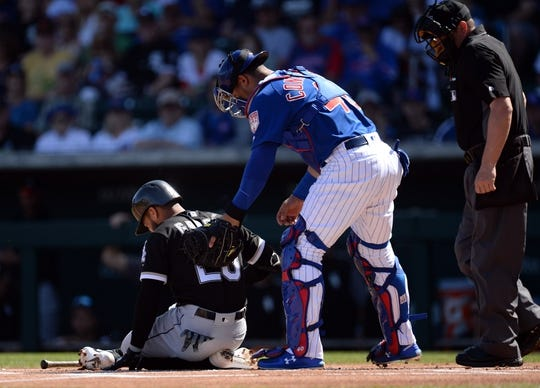Mar 3, 2019; Mesa, AZ, USA; Chicago White Sox right fielder Leury Garcia (28) is checked on by Chicago Cubs catcher Willson Contreras (40) after fouling a ball off his foot  during the first inning at Sloan Park. Mandatory Credit: Joe Camporeale-USA TODAY Sports