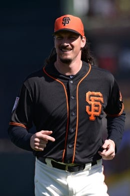 Mar 9, 2019; Scottsdale, AZ, USA; San Francisco Giants starting pitcher Jeff Samardzija (29) runs during warmups before the game against the Chicago Cubs at Scottsdale Stadium. Mandatory Credit: Orlando Ramirez-USA TODAY Sports