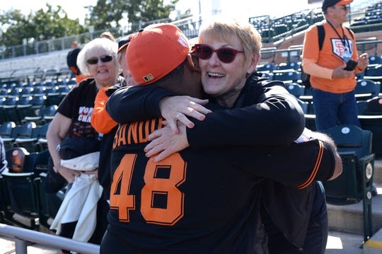 Mar 9, 2019; Scottsdale, AZ, USA; San Francisco Giants third baseman Pablo Sandoval (48) hugs fan Louise McCoskey of Modesto, California before the game against the Chicago Cubs at Scottsdale Stadium. Mandatory Credit: Orlando Ramirez-USA TODAY Sports