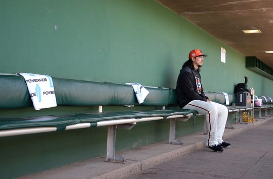 Mar 9, 2019; Scottsdale, AZ, USA; San Francisco Giants starting pitcher Dereck Rodriguez (57) sits in the dugout before his start against the Chicago Cubs at Scottsdale Stadium. Mandatory Credit: Orlando Ramirez-USA TODAY Sports