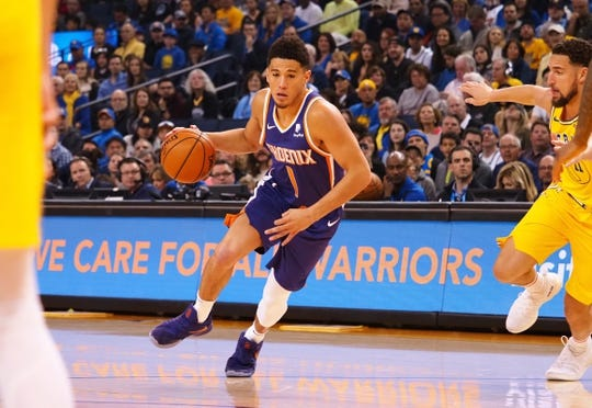 Mar 10, 2019; Oakland, CA, USA; Phoenix Suns guard Devin Booker (1) controls the ball against the Golden State Warriors during the first quarter at Oracle Arena. Mandatory Credit: Kelley L Cox-USA TODAY Sports