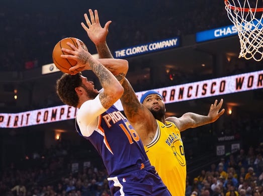 Mar 10, 2019; Oakland, CA, USA; Golden State Warriors center DeMarcus Cousins (0) defends the shot by Phoenix Suns guard Tyler Johnson (16) during the first quarter at Oracle Arena. Mandatory Credit: Kelley L Cox-USA TODAY Sports
