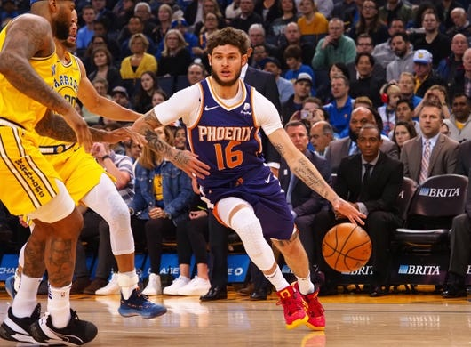 Mar 10, 2019; Oakland, CA, USA; Phoenix Suns guard Tyler Johnson (16) dribbles the ball against the Golden State Warriors during the first quarter at Oracle Arena. Mandatory Credit: Kelley L Cox-USA TODAY Sports