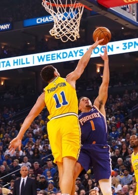 Mar 10, 2019; Oakland, CA, USA; Golden State Warriors guard Klay Thompson (11) blocks the shot by Phoenix Suns guard Devin Booker (1) during the first quarter at Oracle Arena. Mandatory Credit: Kelley L Cox-USA TODAY Sports