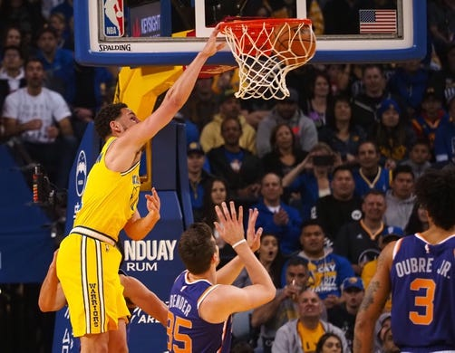 Mar 10, 2019; Oakland, CA, USA; Golden State Warriors guard Klay Thompson (11) dunks the ball against the Phoenix Suns during the first quarter at Oracle Arena. Mandatory Credit: Kelley L Cox-USA TODAY Sports