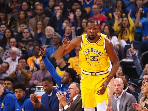 Mar 10, 2019; Oakland, CA, USA; Golden State Warriors forward Kevin Durant (35) gestures after a basket against the Phoenix Suns during the first quarter at Oracle Arena. Mandatory Credit: Kelley L Cox-USA TODAY Sports