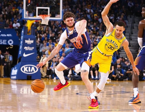 Mar 10, 2019; Oakland, CA, USA; Phoenix Suns guard Tyler Johnson (16) controls the ball against Golden State Warriors guard Stephen Curry (30) during the second quarter at Oracle Arena. Mandatory Credit: Kelley L Cox-USA TODAY Sports