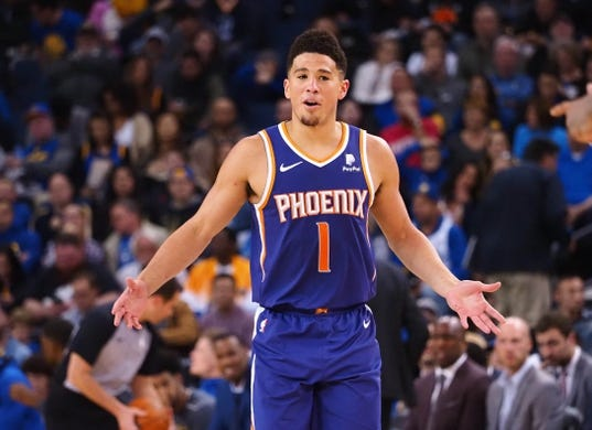 Mar 10, 2019; Oakland, CA, USA; Phoenix Suns guard Devin Booker (1) reacts after a play against the Golden State Warriors during the third quarter at Oracle Arena. Mandatory Credit: Kelley L Cox-USA TODAY Sports