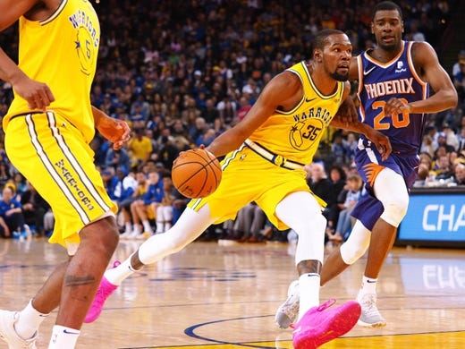 Mar 10, 2019; Oakland, CA, USA; Golden State Warriors forward Kevin Durant (35) drives to the basket against Phoenix Suns forward Josh Jackson (20) during the third quarter at Oracle Arena. Mandatory Credit: Kelley L Cox-USA TODAY Sports