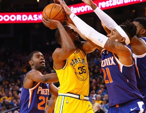 Mar 10, 2019; Oakland, CA, USA; Golden State Warriors forward Kevin Durant (35) is fouled by Phoenix Suns forward Richaun Holmes (21) during the third quarter at Oracle Arena. Mandatory Credit: Kelley L Cox-USA TODAY Sports