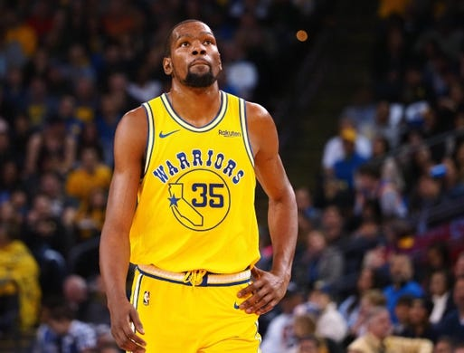 Mar 10, 2019; Oakland, CA, USA; Golden State Warriors forward Kevin Durant (35) reacts between plays against the Phoenix Suns during the third quarter at Oracle Arena. Mandatory Credit: Kelley L Cox-USA TODAY Sports