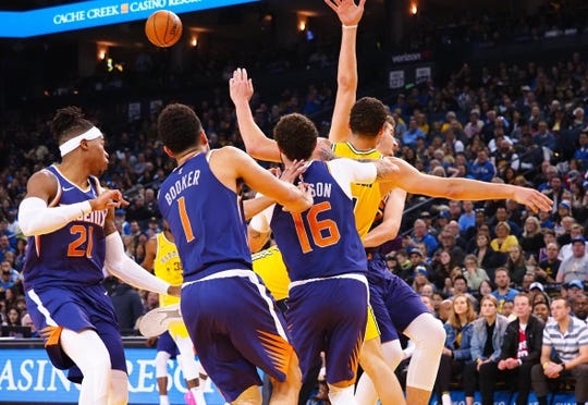 Mar 10, 2019; Oakland, CA, USA; Golden State Warriors guard Klay Thompson (11) is caught between multiple Phoenix Suns players during the third quarter at Oracle Arena. Mandatory Credit: Kelley L Cox-USA TODAY Sports
