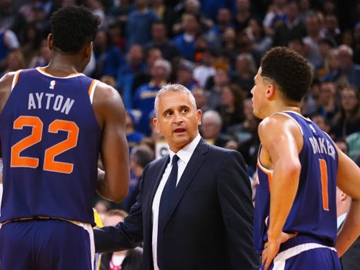 Mar 10, 2019; Oakland, CA, USA; Phoenix Suns head coach Igor Kokoskov speaks to center Deandre Ayton (22) and guard Devin Booker (1) during the fourth quarter against the Golden State Warriors at Oracle Arena. Mandatory Credit: Kelley L Cox-USA TODAY Sports