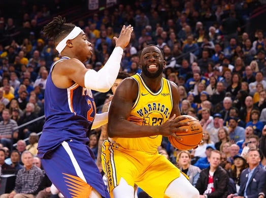 Mar 10, 2019; Oakland, CA, USA; Golden State Warriors forward Draymond Green (23) controls the ball against Phoenix Suns forward Richaun Holmes (21) during the fourth quarter at Oracle Arena. Mandatory Credit: Kelley L Cox-USA TODAY Sports
