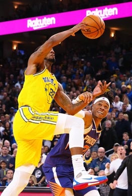 Mar 10, 2019; Oakland, CA, USA; Phoenix Suns forward Richaun Holmes (21) fouls Golden State Warriors forward Alfonzo McKinnie (28) going to the basket during the fourth quarter at Oracle Arena. Mandatory Credit: Kelley L Cox-USA TODAY Sports
