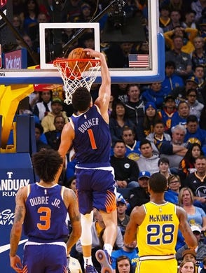 Mar 10, 2019; Oakland, CA, USA; Phoenix Suns guard Devin Booker (1) dunks the ball against the Golden State Warriors during the fourth quarter at Oracle Arena. Mandatory Credit: Kelley L Cox-USA TODAY Sports