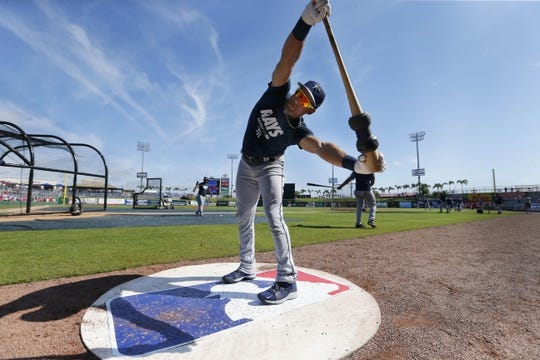 Mar 11, 2019; Clearwater, FL, USA; Tampa Bay Rays center fielder Kevin Kiermaier (39) stretches as he works out prior to the game against the Philadelphia Phillies at Spectrum Field. Mandatory Credit: Kim Klement-USA TODAY Sports