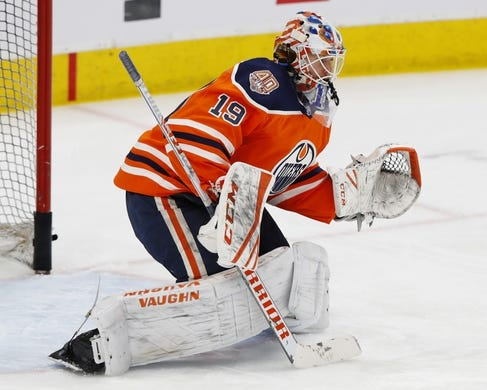 Mar 11, 2019; Edmonton, Alberta, CAN; Edmonton Oilers goaltender Mikko Koskinen (19) makes a save during warmups against the New York Rangers at Rogers Place. Mandatory Credit: Perry Nelson-USA TODAY Sports