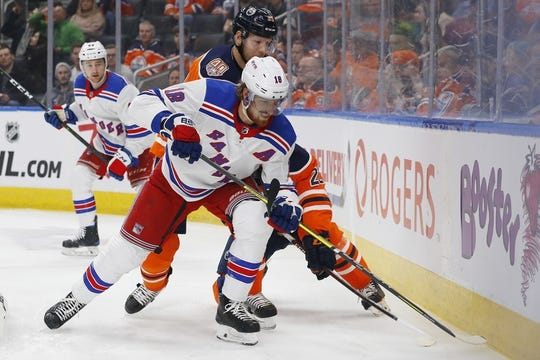 Mar 11, 2019; Edmonton, Alberta, CAN;New York Rangers defensemen Marc Staal (18) and Edmonton Oilers forward Alex Chiasson (39) battle along the boards for a loose puck  during the first period at Rogers Place. Mandatory Credit: Perry Nelson-USA TODAY Sports