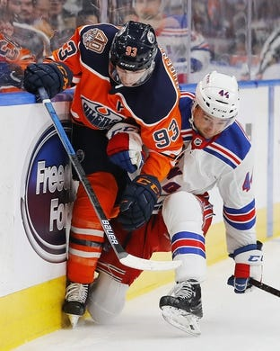 Mar 11, 2019; Edmonton, Alberta, CAN; New York Rangers defensemen Neal Pink (44) checks Edmonton Oilers forward Ryan Nugent-Hopkins (93) during the first period at Rogers Place. Mandatory Credit: Perry Nelson-USA TODAY Sports