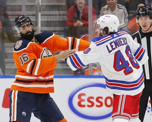 Mar 11, 2019; Edmonton, Alberta, CAN; Edmonton Oilers forward Jujhar Khaira (16) and New York Rangers forward Brendan Lemieux (48) fight during the second period at Rogers Place. Mandatory Credit: Perry Nelson-USA TODAY Sports