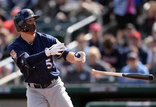Mar 13, 2019; Goodyear, AZ, USA; Milwaukee Brewers third baseman Cory Spangenberg (5) flips his bat after striking out against the Cleveland Indians during the first inning at Goodyear Ballpark. Mandatory Credit: Joe Camporeale-USA TODAY Sports