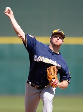 Mar 13, 2019; Goodyear, AZ, USA; Milwaukee Brewers starting pitcher Chase Anderson (57) pitches against the Cleveland Indians during the first inning at Goodyear Ballpark. Mandatory Credit: Joe Camporeale-USA TODAY Sports
