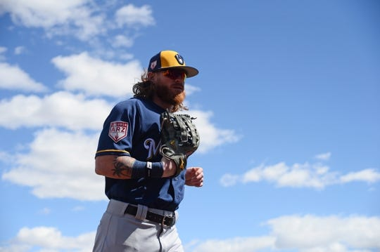 Mar 13, 2019; Goodyear, AZ, USA; Milwaukee Brewers left fielder Ben Gamel (16) returns to the dugout after the first inning against the Cleveland Indians at Goodyear Ballpark. Mandatory Credit: Joe Camporeale-USA TODAY Sports