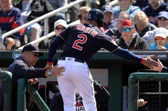 Mar 13, 2019; Goodyear, AZ, USA; Cleveland Indians center fielder Leonys Martin (2) is welcomed by Cleveland Indians manager Terry Francona (left) after scoring a run against the Milwaukee Brewers during the first inning at Goodyear Ballpark. Mandatory Credit: Joe Camporeale-USA TODAY Sports