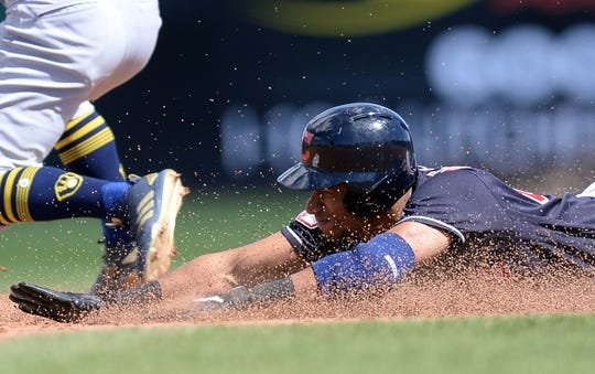Mar 13, 2019; Goodyear, AZ, USA; Cleveland Indians shortstop Oscar Mercado (67) dives into second base for a double against the Milwaukee Brewers during the second inning at Goodyear Ballpark. Mandatory Credit: Joe Camporeale-USA TODAY Sports