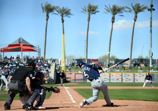 Mar 13, 2019; Goodyear, AZ, USA; Milwaukee Brewers third baseman Cory Spangenberg (5) bats against the Cleveland Indians during the fifth inning at Goodyear Ballpark. Mandatory Credit: Joe Camporeale-USA TODAY Sports