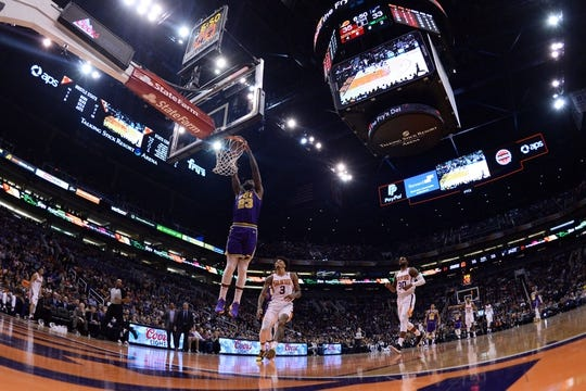Mar 13, 2019; Phoenix, AZ, USA; Utah Jazz forward Royce O'Neale (23) dunks against the Phoenix Suns during the first half at Talking Stick Resort Arena. Mandatory Credit: Joe Camporeale-USA TODAY Sports