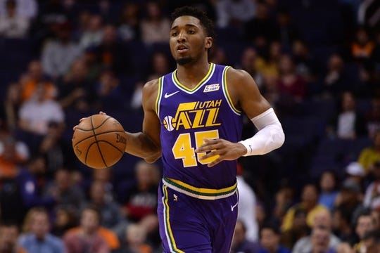 Mar 13, 2019; Phoenix, AZ, USA; Utah Jazz guard Donovan Mitchell (45) dribbles against the Phoenix Suns during the first half at Talking Stick Resort Arena. Mandatory Credit: Joe Camporeale-USA TODAY Sports