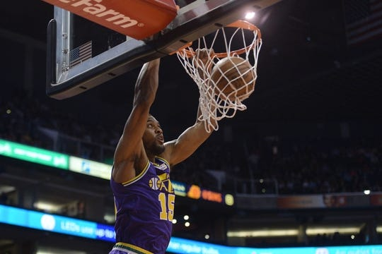 Mar 13, 2019; Phoenix, AZ, USA; Utah Jazz forward Derrick Favors (15) dunks against the Phoenix Suns during the first half at Talking Stick Resort Arena. Mandatory Credit: Joe Camporeale-USA TODAY Sports