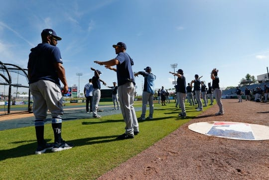 Mar 11, 2019; Clearwater, FL, USA; Tampa Bay Rays second baseman Emilio Bonifacio (64) and shortstop Willy Adames (1) talk as they stretch and workout prior to the game against the Philadelphia Phillies at Spectrum Field. Mandatory Credit: Kim Klement-USA TODAY Sports