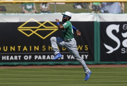 Mar 17, 2019; Scottsdale, AZ, USA; Kansas City Royals center fielder Brian Goodwin (25) warms up before a spring training game against the San Francisco Giants at Scottsdale Stadium. Mandatory Credit: Rick Scuteri-USA TODAY Sports