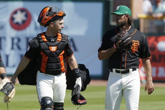 Mar 17, 2019; Scottsdale, AZ, USA; San Francisco Giants catcher Buster Posey (28) and Madison Bumgarner (40) talk before a spring training game against the Kansas City Royals at Scottsdale Stadium. Mandatory Credit: Rick Scuteri-USA TODAY Sports