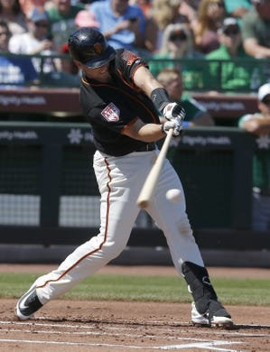 Mar 17, 2019; Scottsdale, AZ, USA; San Francisco Giants catcher Buster Posey (28) hits against the Kansas City Royals in the first inning during a spring training game at Scottsdale Stadium. Mandatory Credit: Rick Scuteri-USA TODAY Sports