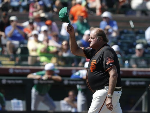 Mar 17, 2019; Scottsdale, AZ, USA; TV analyst Chris Berman acknowledges the fans with the San Francisco Giants in the third inning during a spring training game against the Kansas City Royals at Scottsdale Stadium. Mandatory Credit: Rick Scuteri-USA TODAY Sports